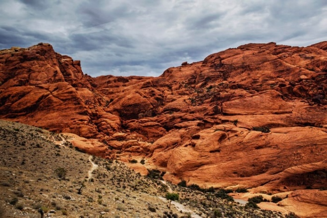 desert with red, rocky hills