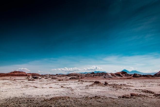 barren land with deep blue sky